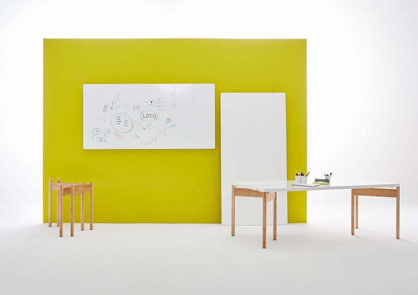Moving Walls' latest office table doubles up as a wall writing panel