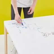 Moving Walls' latest office table doubles up as a wall-hung whiteboard