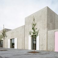 Five concrete boxes with pink doors form the Tim Van Laere Gallery in Antwerp