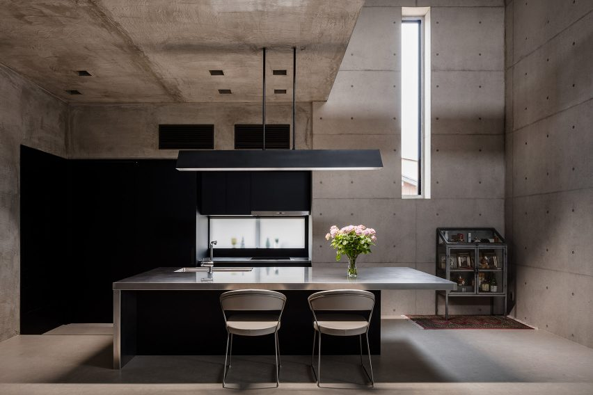 Bare concrete dining room in Tranquil House by FORM Kouichi Kimura Architects
