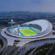 Aluminium louvres and a membrane roof shade Wuyuanhe Stadium by GMP Architekten
