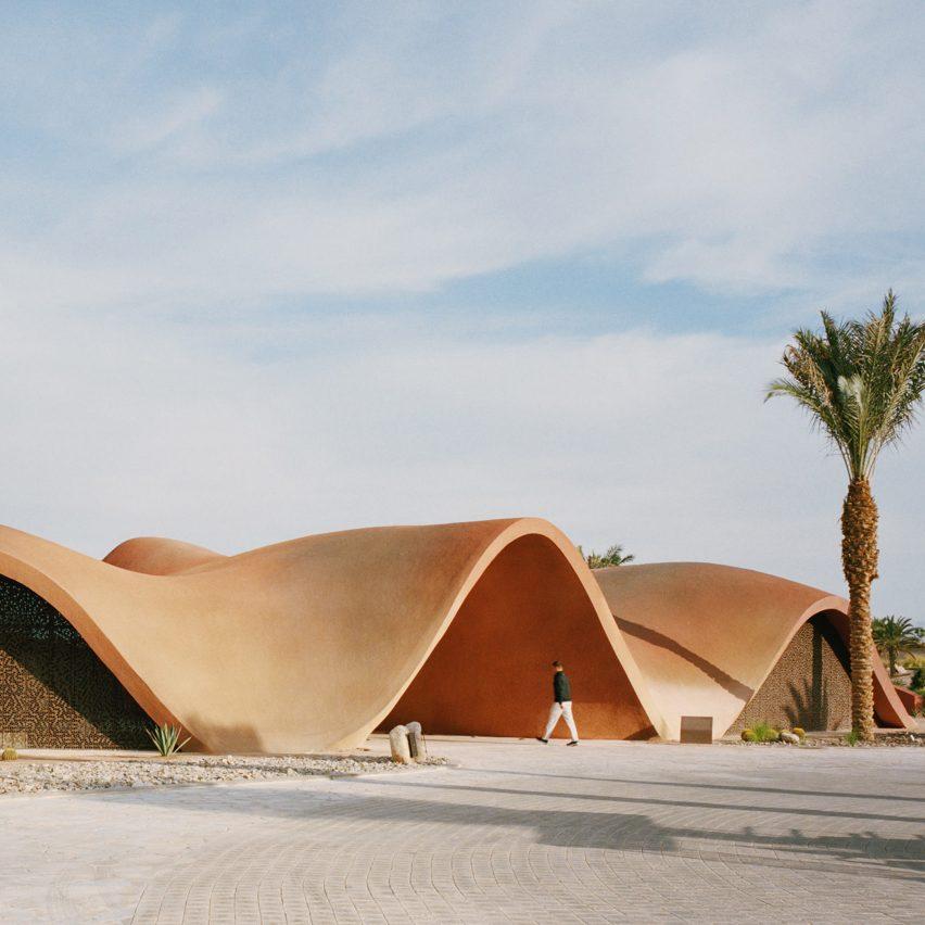 Oppenheim Architecture's sinuous concrete golf clubhouse mimics Jordan's desertscape
