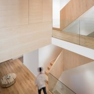 StudioAC inserts wooden staircase and bedroom boxes into 140-year-old Toronto home