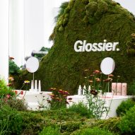 Glossier pop-up shop in Seattle features rolling hills covered in moss and flowers