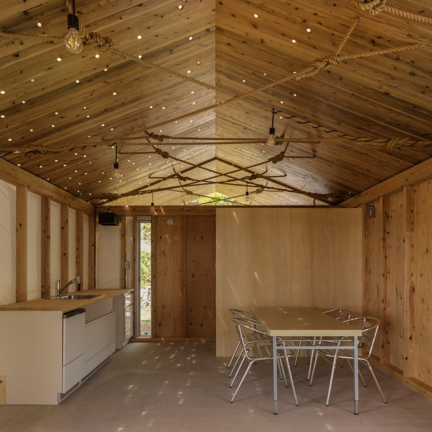 ICADA intentionally puts holes in roof of small wooden house in Japan