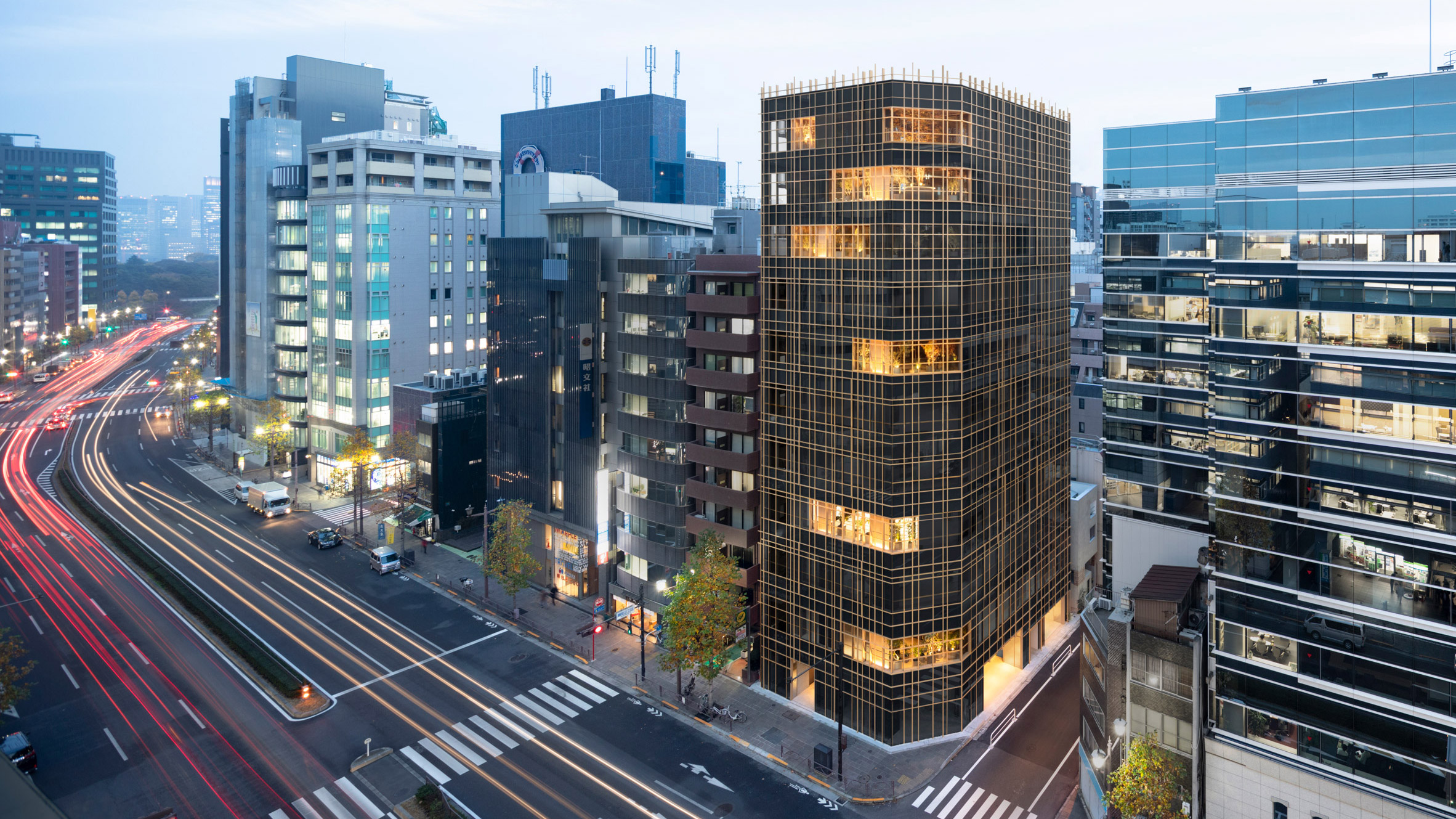 Nendo wraps timber grid around plant-filled balconies of Japanese office