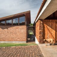 Solo Arquitetos builds Brazilian holiday home Casa do Lago using reclaimed bricks and local stones