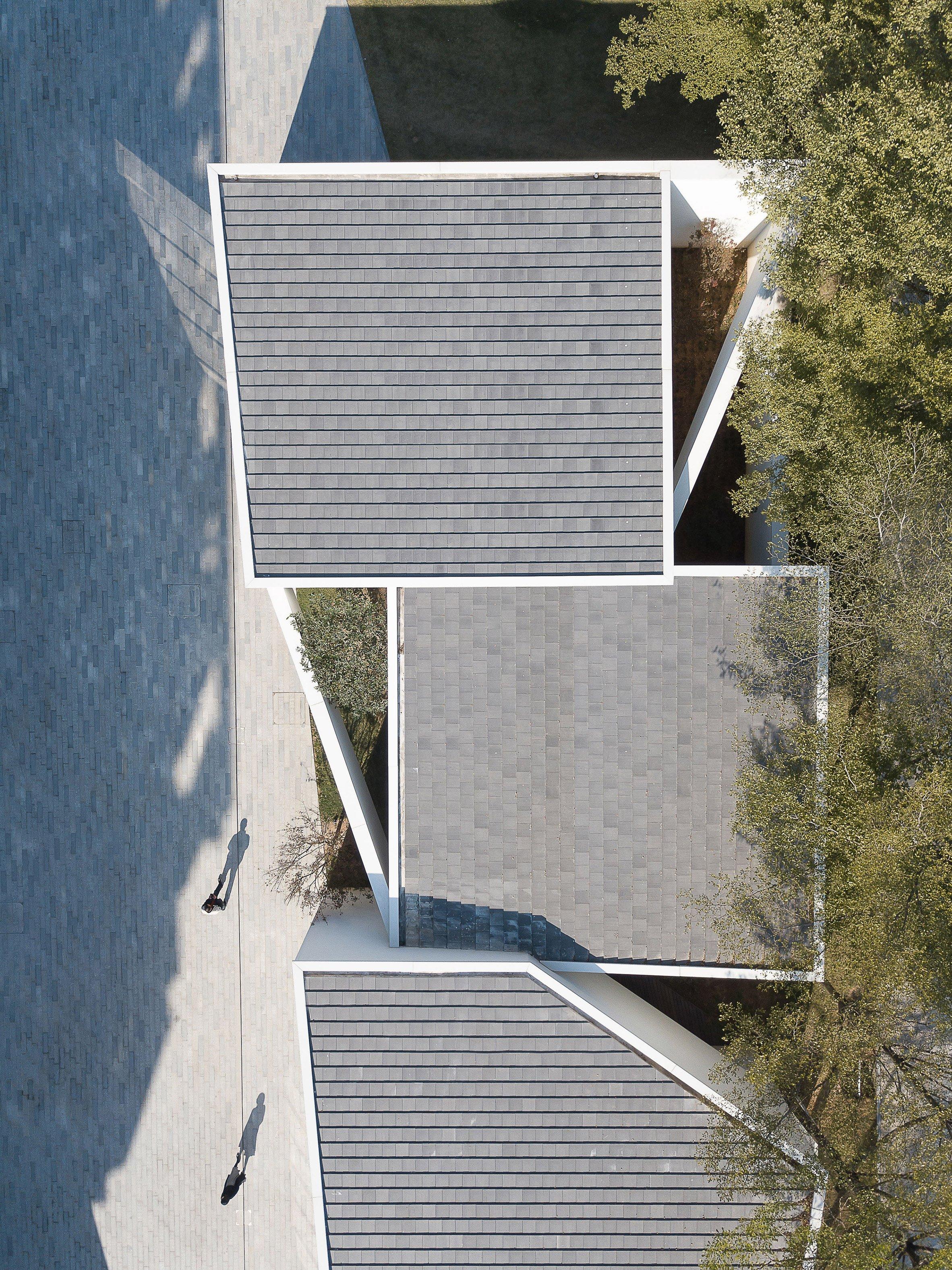 9cc597a5454fc Six interlocking concrete blocks form Living Art Pavilion in ...