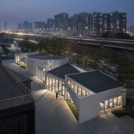 Six interlocking concrete blocks form Living Art Pavilion in Shenzhen