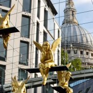 Lunch Break angels swing above commuters passing St Paul's Cathedral in London
