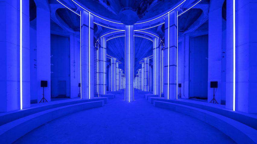 AMO creates blue-lit runway in Shanghai's Silo Hall for Prada menswear show