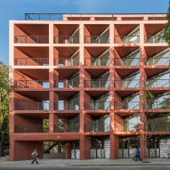 BBGK explores potential of prefabrication with red concrete housing block in Poland