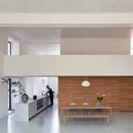 Eklund Terbeek creates loft-style apartment within a former school gymnasium