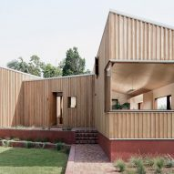 TRIAS Architects raises timber Three Piece House on a red brick base