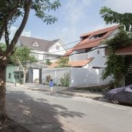 K59 Atelier's Tile Roof House takes cues from traditional Vietnamese homes