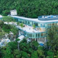 Revery Architecture designs snaking glass campus on Hong Kong hillside