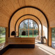 Valbæk Brørup Architects designs barrel-vaulted cabin in Danish forest