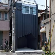 Geneto raises skinny house in Japan above pentagonal garage hole