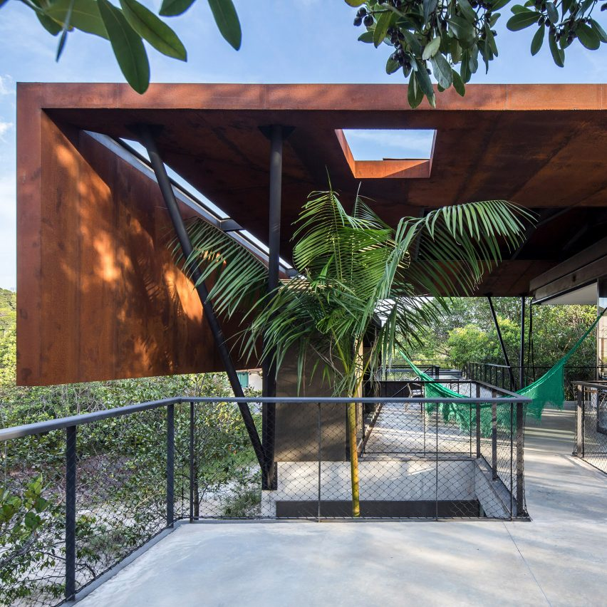 Laurent Troost Architects folds weathered steel roof over concrete house in Brazilian Amazon