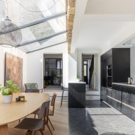 Hackney House features black joinery and a back-garden sauna