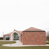 WE-S Architecten adds diagonal brick extension to Belgian bungalow