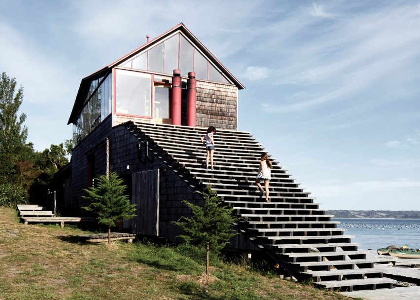 Guillermo Acuña fronts his remote Chilean retreat with large wooden staircase