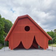 Red wooden curtain surrounds nature reserve entrance pavilion by Sandellsandberg
