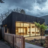 SERA expands Portland Playhouse with building wrapped in glass and charred wood