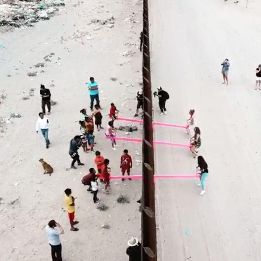 Rael San Fratello slots pink seesaws into US-Mexico border wall