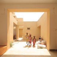 Urko Sanchez Architects builds miniature walled city for orphans