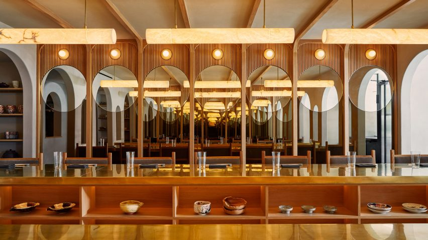A wood-lined Japanese restaurant with alabaster lights