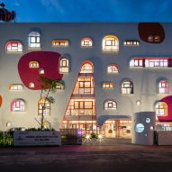 TTC Elite Saigon Kindergarten in by Kientruc O in has a distinctive facade decorated with colourful patches and irregularly shaped windows.