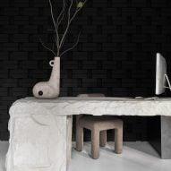 Yakusha Design applies dark tones throughout its Kyiv offices