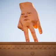 """Giant hybrid face-hand"" installed on roof of art gallery in Wellington"