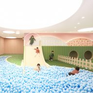 Karv One Design builds school around giant slide and ball pit
