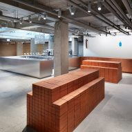 Schemata Architects stacks up red bricks inside South Korea's first Blue Bottle Coffee cafe