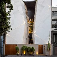 Cleft House in India is split in two by full-height atrium