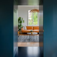 "Bureau Brisson Architectes updates Swiss ""hybrid"" home with blue cabinetry"