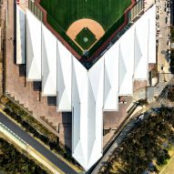 Angular white roof covers Mexico City baseball stadium by FGP Atelier and Taller ADG