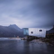 Aluminium-clad cabins perch on stilts over the Barents Sea in Norway