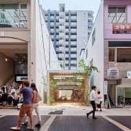Yabashi Architects slots cafe and pocket park between buildings in Kyushu