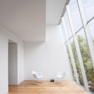 Big slanted window tops renovated Brooklyn townhouse by PRO