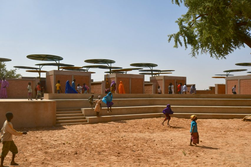 Colourful metal canopies shade Dandaji market in Niger by Atelier Masomi
