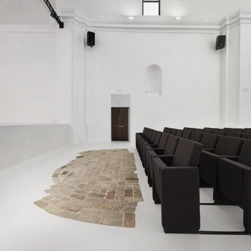 Stark monochromatic interior of Saint Rocco church brings stone ruins into focus