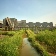 Zigzag thatched bamboo roofs shade classrooms of school in Indonesia