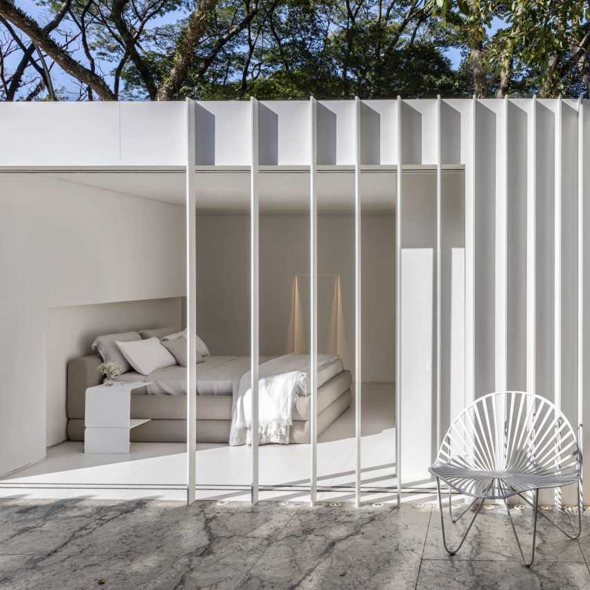 Two shipping containers contain a micro home furnished with Nendo