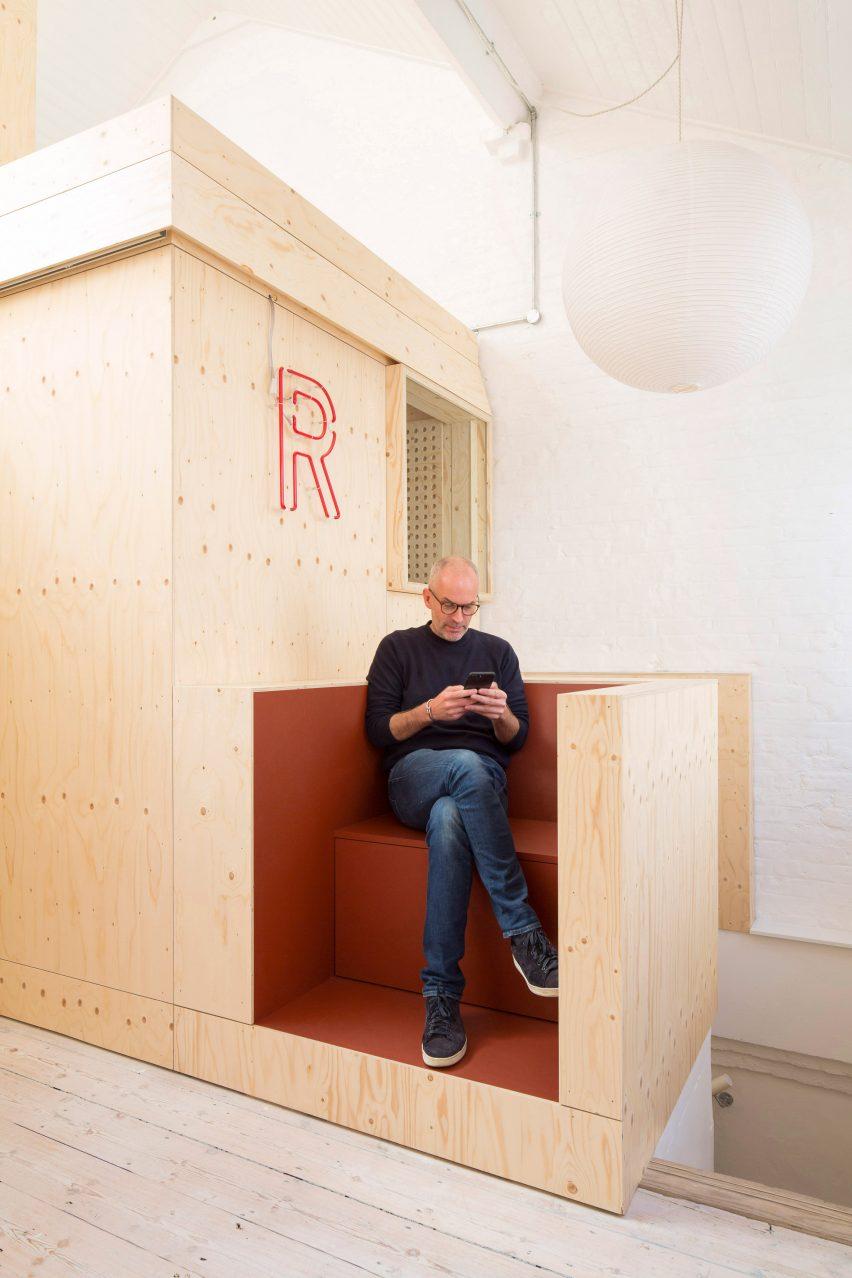 Seating area in Studio Represent wood office by Alder Brisco