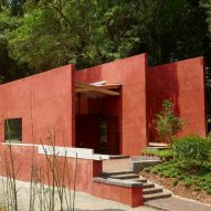 Red concrete walls enclose The Walls teaching restaurant for children in China