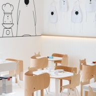 White & The Bear children's restaurant has white surfaces and timber furnishings