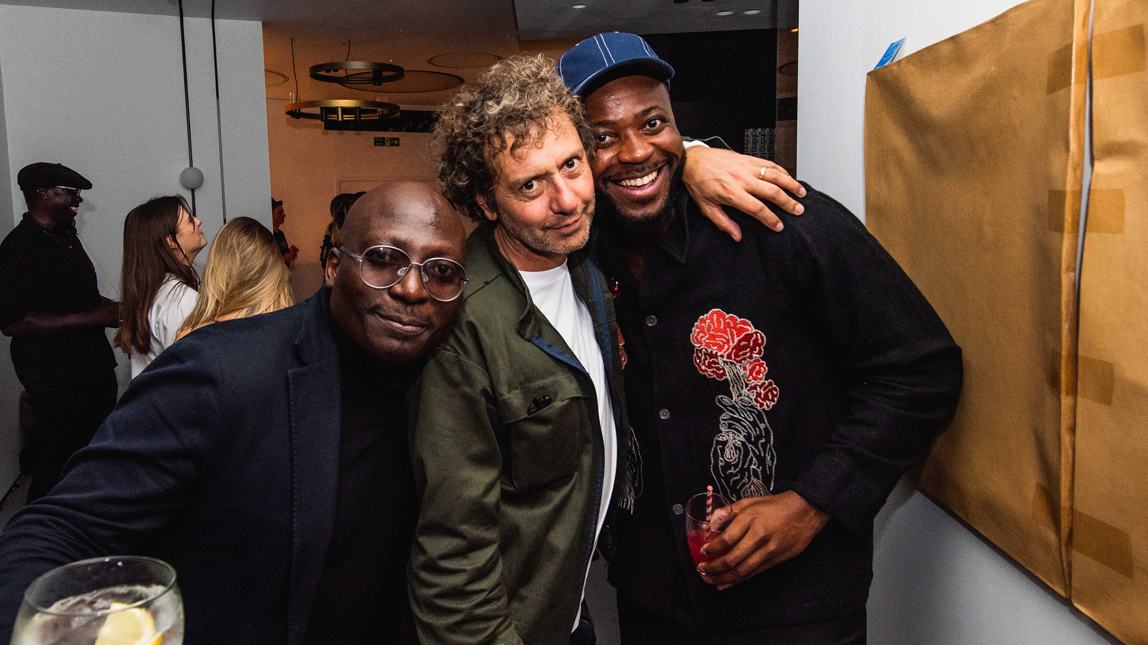 NLÉ founder Kunlé Adeyemi with Dezeen's Marcus Fairs and designer Yinka Ilori